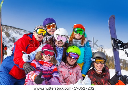 Portrait of seven smiling friends wearing goggles