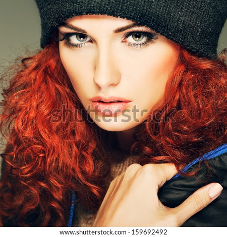 Portrait of sexual beautiful redheaded girl in a sportwear, is in fashion style - stock photo