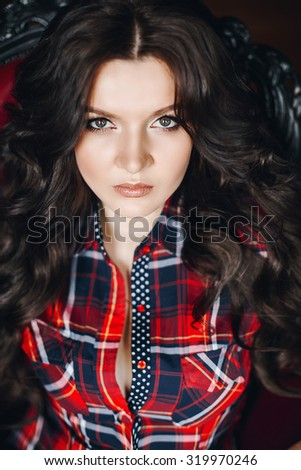 portrait of Sexy brunette with long hair in a plaid shirt  - stock photo