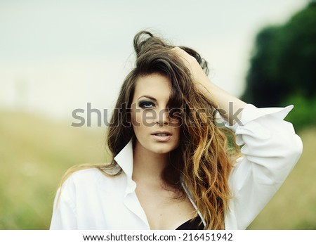 Portrait of sexy brunette woman in fashion style - stock photo