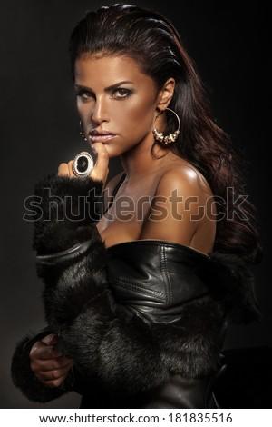 Portrait of sexy brunette woman wearing jewelry. - stock photo