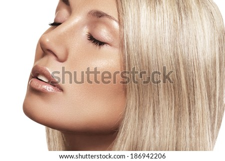 Portrait of sexy caucasian young woman. Natural beauty with pure skin. Beautiful model with natural make-up, clean skin, blond hair bun on beige background.  - stock photo