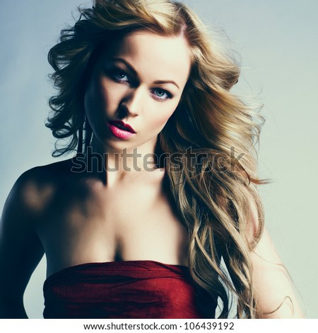 portrait of sexy caucasian young woman with long blond hair, beautiful eyes, sensual lips and clean skin - stock photo
