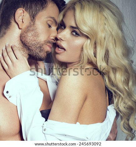 Portrait of sexy couple - stock photo