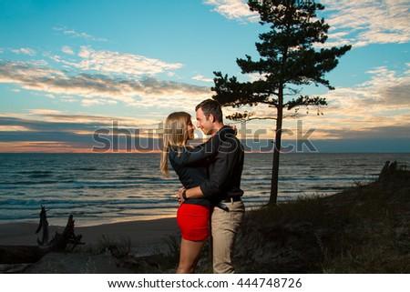 Portrait of sexy couple posing on the beach - stock photo