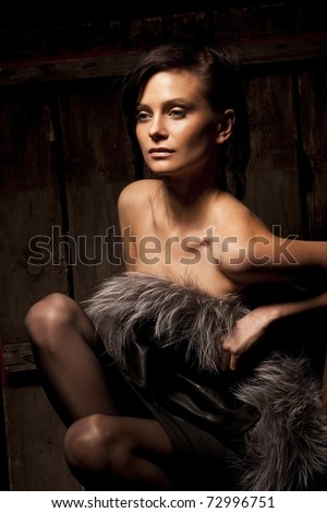 Portrait of sexy girl posing on dark wood background