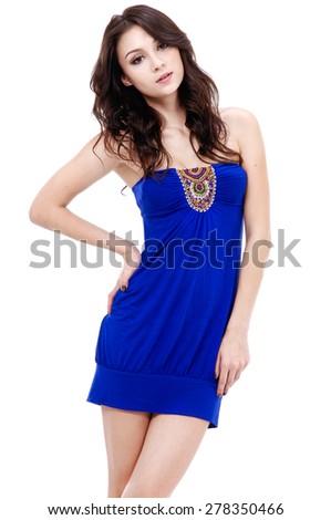 Portrait of sexy girl wearing blue dress posing in studio - stock photo