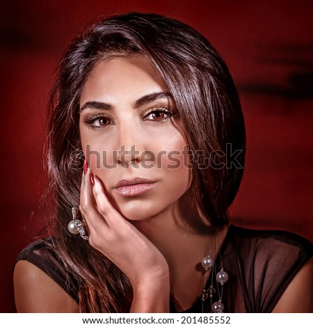 Portrait of sexy gorgeous female isolated on dark red background, beautiful fashionable makeup, healthy glossy hair, beauty salon concept - stock photo