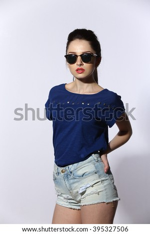 portrait of sexy hipster beautiful young lady wearing jeans long sleeve short on white background