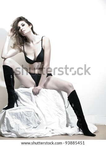 Portrait of sexy leggy women posing in the studio on light background - stock photo