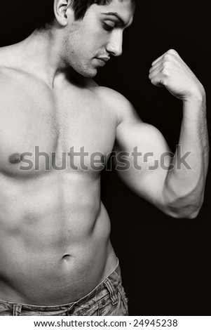 Portrait of sexy muscular man showing his biceps - stock photo