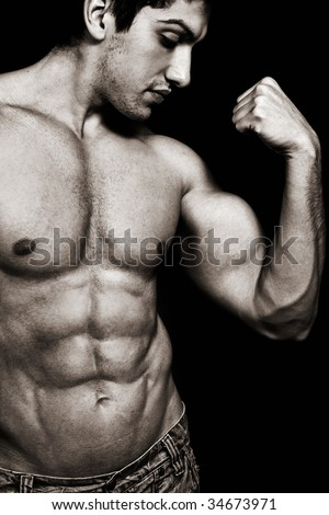 Portrait of sexy muscular man showing his biceps