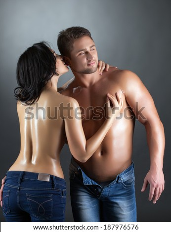 Portrait of sexy topless partners posing in studio