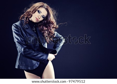 portrait of sexy woman  over dark background