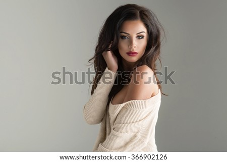 Portrait of sexy woman with long curly hair. Studio shot.  - stock photo