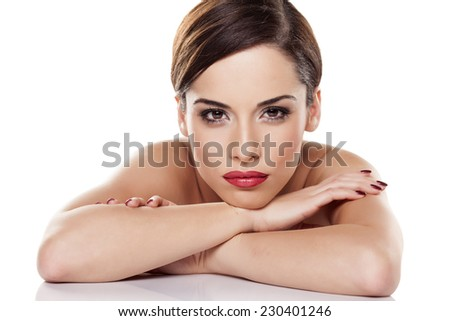 portrait of sexy young brunette lying on white background - stock photo