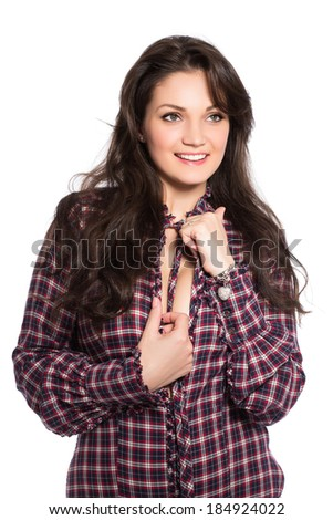 Portrait of sexy young brunette wearing checked shirt. Isolated on white