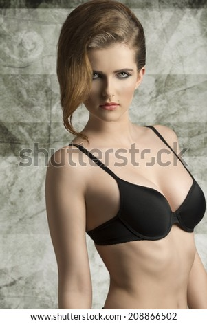 portrait of sexy young girl with trendy hair-style and black bra, sensual eyes looking in camera  - stock photo