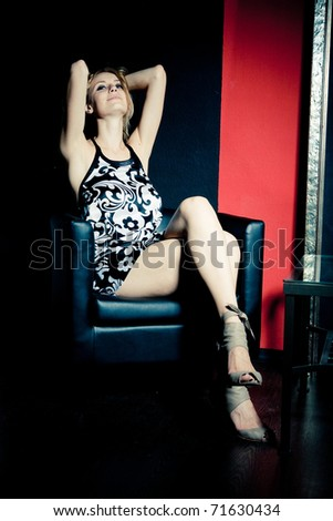 portrait of sexy young woman in office - stock photo