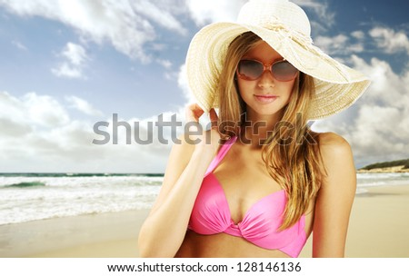 Portrait of sexy young woman on the beach - stock photo