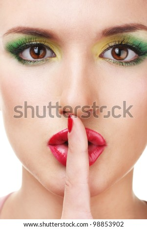 portrait of sexy young woman with glamour make up and red manicure (focus on finger) - stock photo