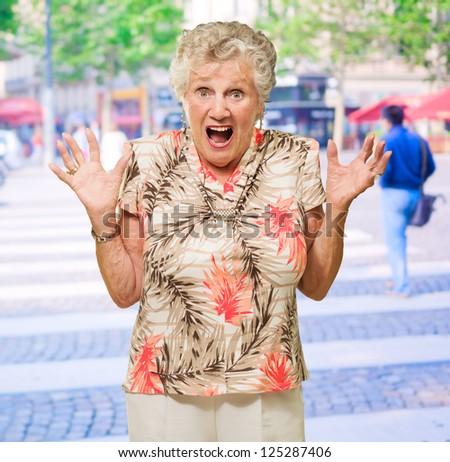 Portrait Of Shocked Senior Woman, Outdoors - stock photo