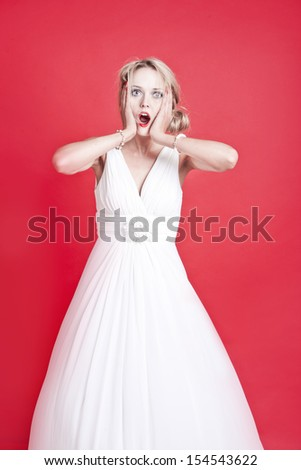 Portrait of shocked young Caucasian woman - stock photo