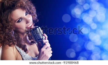Portrait of singing woman - stock photo
