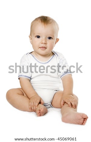 Portrait of  sitting down small child Isolated on white.