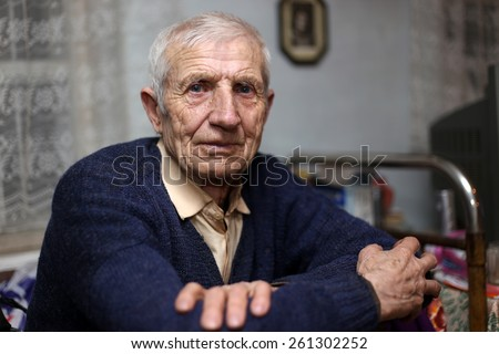portrait of  sitting senior man at home  - stock photo