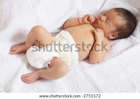 portrait of sleeper newborn baby in the modern nappy
