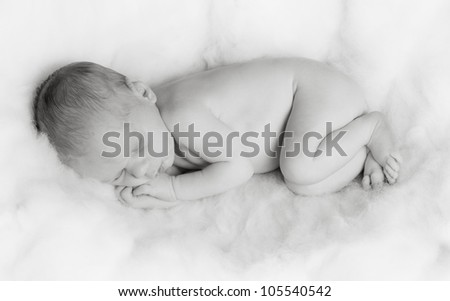 Portrait of sleeping newborn, black and white - stock photo
