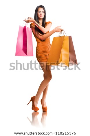 Portrait of slender brunette beauty with colorful shopping bags. - stock photo