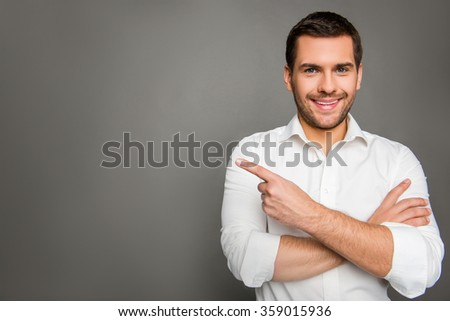 Portrait of smaling man gesturing with crossed hands - stock photo