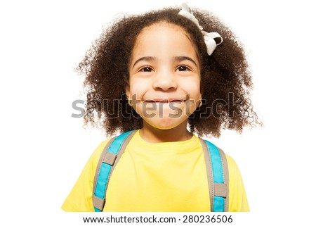Portrait of small African girl in yellow T-shirt - stock photo