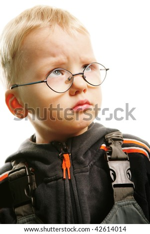 Portrait of small boy with capricious expression over white background - stock photo