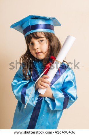Portrait of small caucasian girl graduation from kindergarten with white rolled paper in hand - stock photo
