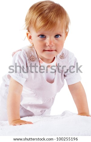 Portrait of small girl looking at camera with serene expression