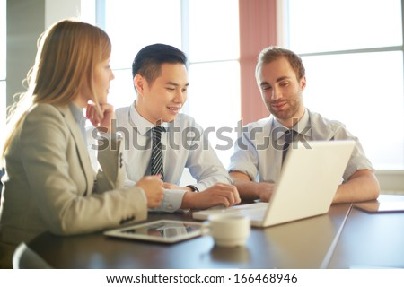 Portrait of smart business partners networking at meeting