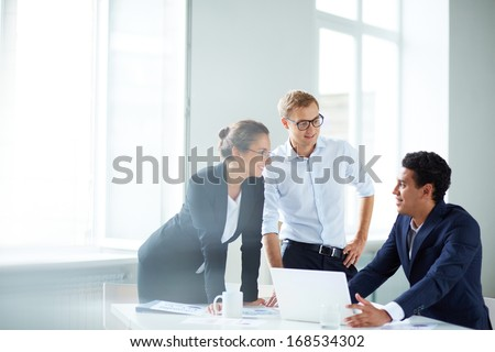 Portrait of smart business partners planning work at meeting - stock photo
