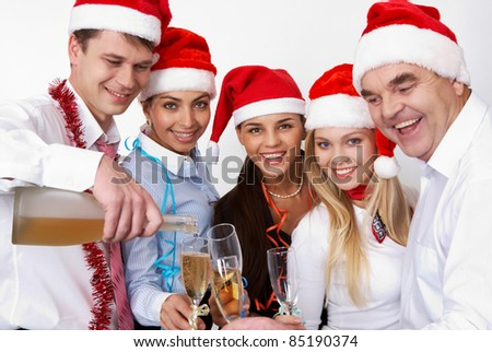 Portrait of smart colleagues with flutes of champagne while toasting - stock photo