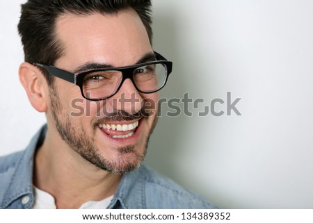 Portrait of smart guy with eyeglasses on
