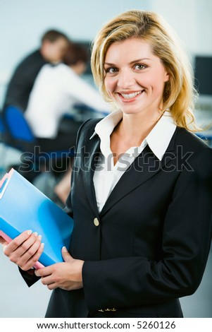 Portrait of smart smiling business woman holding the folders - stock photo