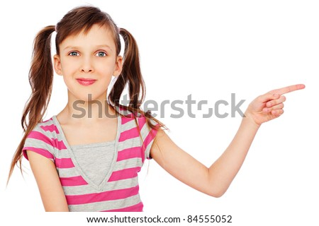 portrait of smiley little girl pointing at something. isolated on white background - stock photo