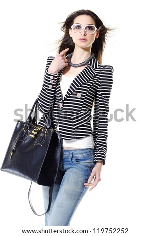 portrait of smiley stylish woman holding bag over white background - stock photo