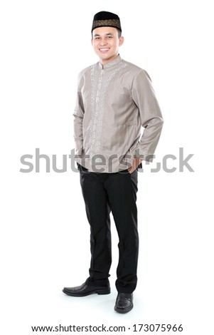 portrait of smiling asian muslim man isolated over white background - stock photo