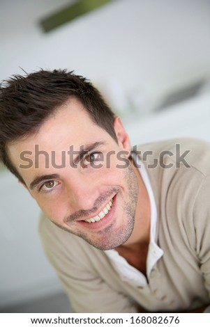 Portrait of smiling attractive man - stock photo