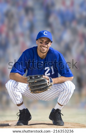 Portrait of smiling baseball player - stock photo