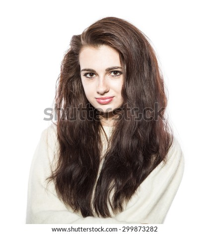 Portrait of smiling beautiful brunette model with freckles and long hair in yellow sweater. Isolated on a white background. - stock photo