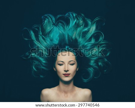 Portrait of smiling beautiful girl with closed eyes and long hair of turquoise color, top view. Image of mermaid - stock photo